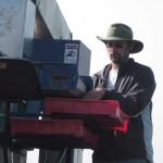 Dean on the fruit harvester